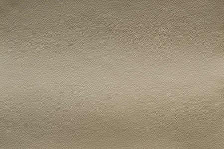Beige leather texture with light vertical stretch, background. Imagens