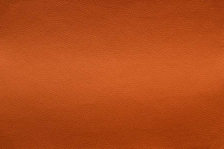 Orange leather texture with light vertical stretch, background.