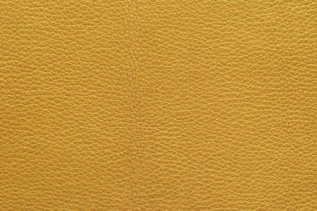 Texture of the leather surface golden metallic, background.
