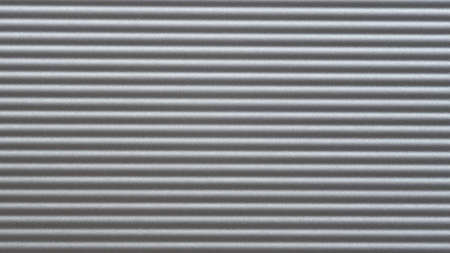 The texture of aluminium with horizontal fluting, background.