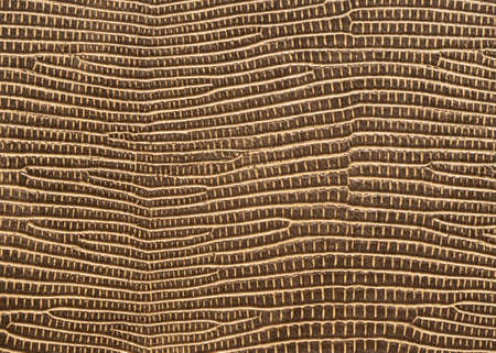 Plastic texture imitation of brown leather, background. Imagens