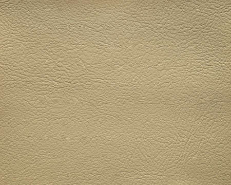 The leather texture pale brown in color, background.