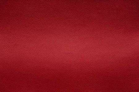 Orange leather texture with light stretch, background.