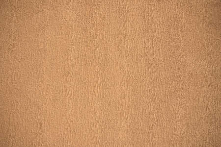 The texture of the decorative plaster brown color, background.