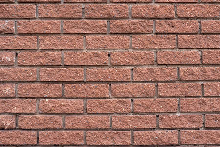 The texture of a brown decorative brick wall, background.