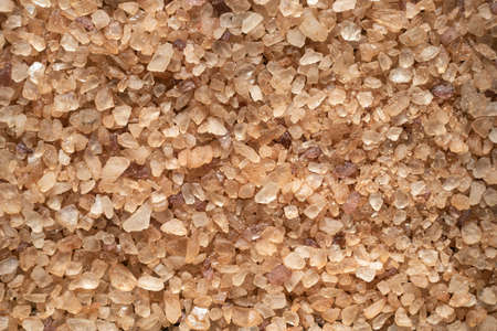 Close up texture of brown salt crystals, background.