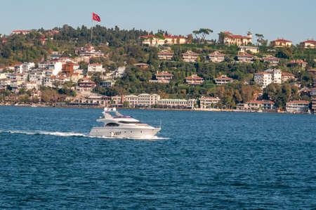 White boat sailing on the Bosphorus, Istanbul.