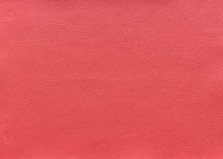 The surface texture of pink leather, background.