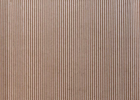 Texture of vertically corrugated brown cardboard, background. Imagens