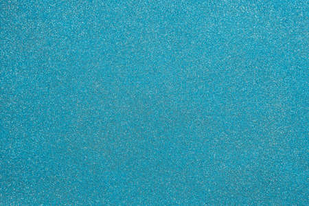 Texture of decorative blue plaster with white dots, background.
