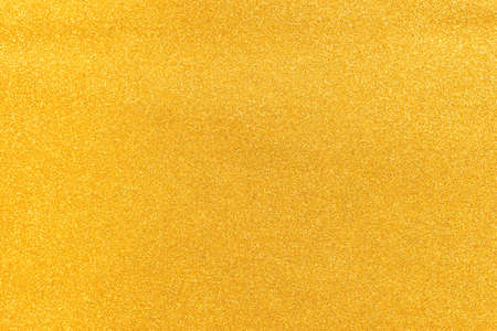 Decorative golden plaster with white dots, background.