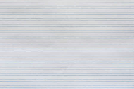 The texture of the sheet in a narrow ruler, background.