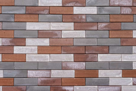 White, grey and red brick in the wall, background Imagens
