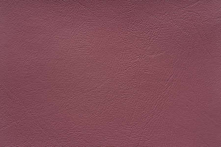 The surface texture of red-brown leather., background.