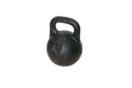 Old metal sports kettlebell, isolated on white background. Imagens