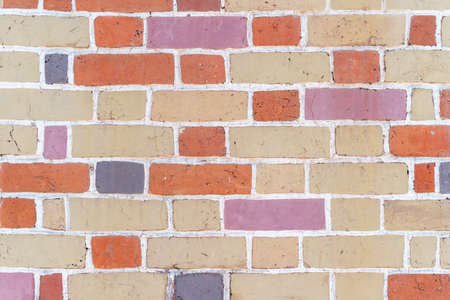 Brick wall, masonry of bricks of different colors, background.
