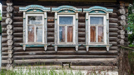 Facade of an old log house, Russia.