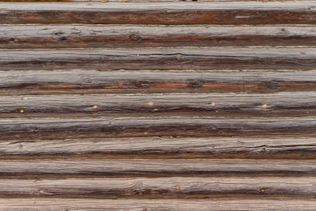 Wood texture of the wall of an old log house, background Imagens