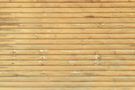 The texture of the wall made of horizontal wooden slats, background.