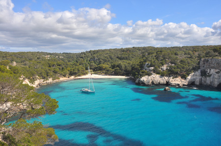 turquoise water in bay on spanish balearic island Menorca Stock Photo