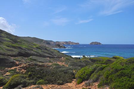 Green coastal landscape on spanish balearic island Menorca Stock Photo