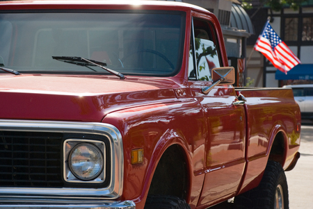 red american chevrolet pick-up truck with flag - USA