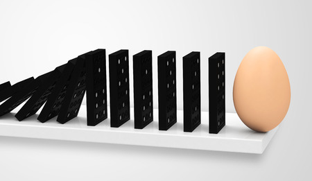 chain reaction: dominoes with a egg Stock Photo