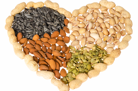 Various healthy grains salty snacks heart shaped photo