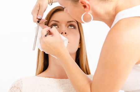Make up artist applying make up on a young and beautiful female model Beauty%20%26%20Fashion%20Lightbox photo