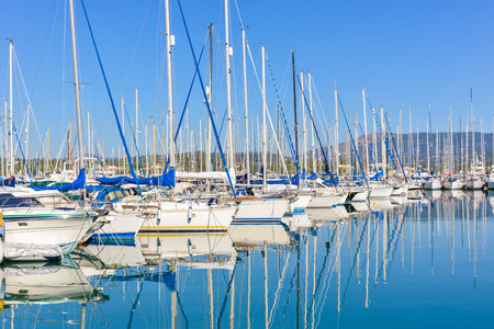 Panorama of a big Gouvia harbour with white yachts and boats on a beautiful sunny day over the island of Corfu photo