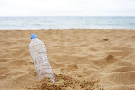 Plastic Bottle Abandoned on the Beach Sand