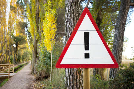 Warning Sign on a forest trail Stock Photo - 16557638