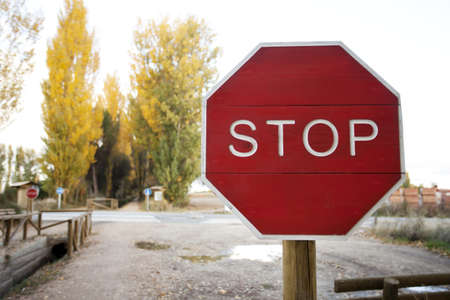 Wood Stop Road Signal on crossroad Stock Photo - 16755747