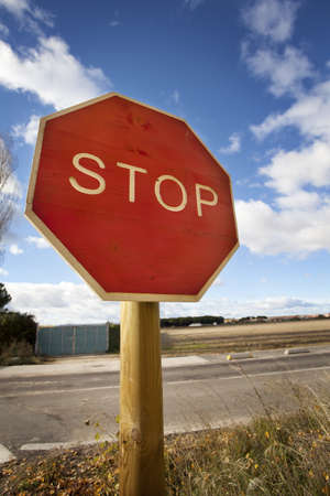 Wood Stop Road Signal on a blue sky day Stock Photo - 16755748