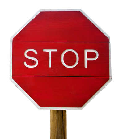 Stop Sign on wooden post. Isolated in White Stock Photo - 16755733