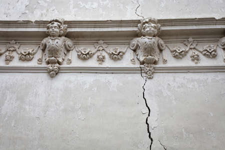Detail of old cracked wall with ornaments in a abandoned church