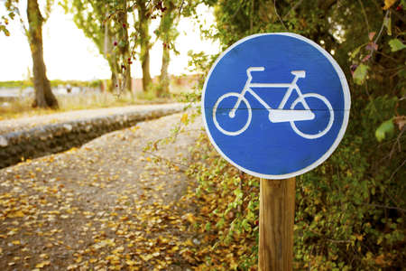 Wooden Post of Bicycle sign on a park. Valladolid, Spain. Stock Photo - 17336515