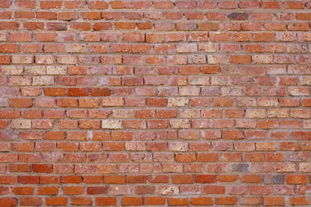red wall: Old brick wall background. Macro shot. Stock Photo