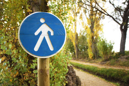 Pedestrian crossing sign on a forest trail Stock Photo - 17336506