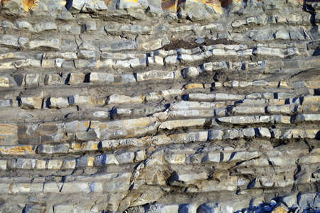 strata: Detail of the different strata from a rock.