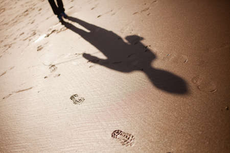 Shadow of a man chasing me Stock Photo