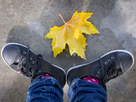youth culture: Feet of Girl and autumn leaf composition