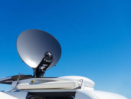 Parked satellite TV van transmits breaking news events to orbiting satellites for broadcast around the world