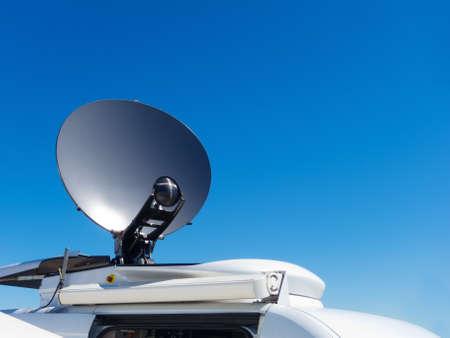 breaking news: Parked satellite TV van transmits breaking news events to orbiting satellites for broadcast around the world