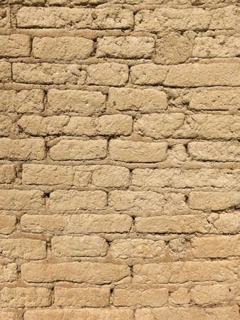 Old adobe brick wall detail for Background or Texture. Macro shot. Stock Photo