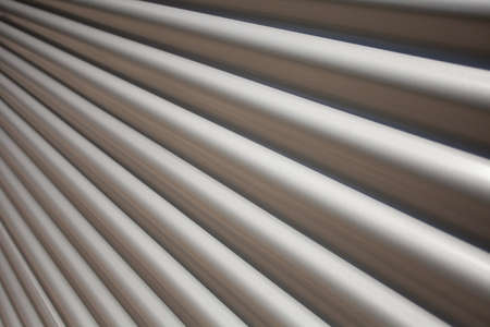 Covering of Corrugated Iron in Diminishing Perspective for Backgrounds or Texture Stock Photo