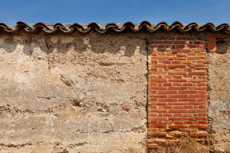 rooftiles: Old wall with tiles detail. Valladolid, Spain. Stock Photo