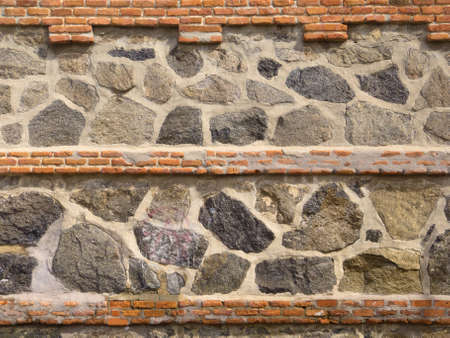 Old Stone and brick Wall for Background or Texture photo