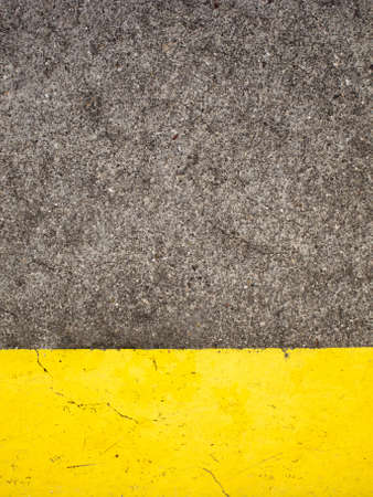 Weathered cement floor background with yellow paint  photo