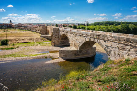 Ancient Roman Bridge in Hospital de Rio Orbigo in the path of the Camino de Santiago. Leon, Spain. Stock Photo